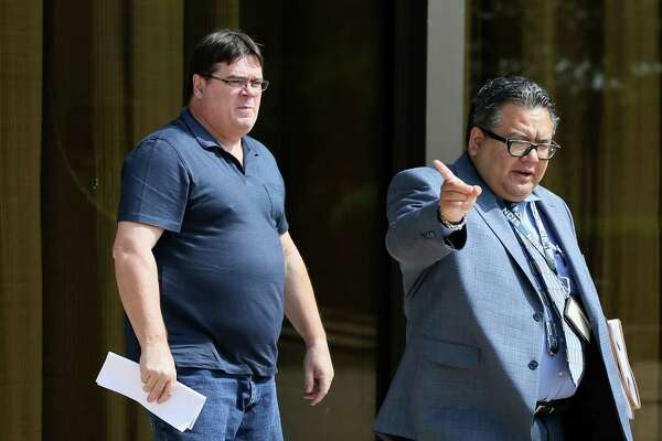 Theodore De Aubrey (left), 57,  a former math teacher at La Vernia High School, leaves the federal courthouse after being released on bond on Friday, May 20, 2016.  De Aubrey was indicted on federal child pornography charges.