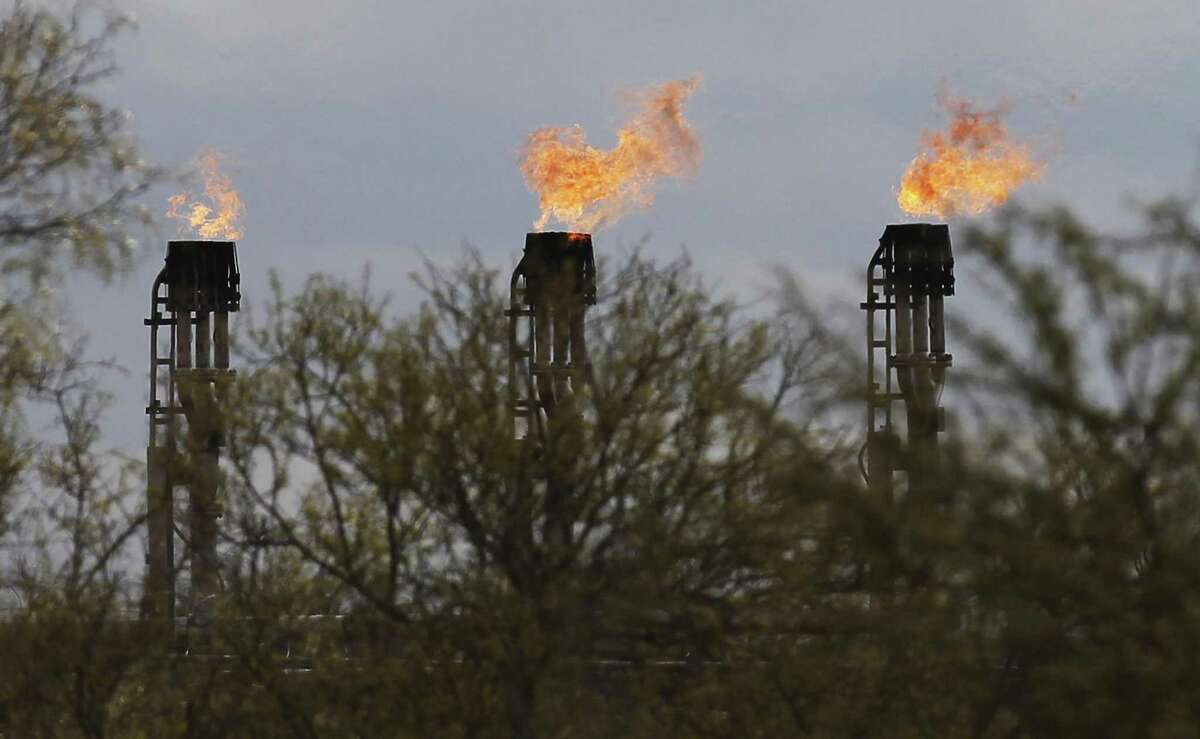 Gas flares burn at Ritchie Farms, an oil lease in La Salle and Dimmit counties, operated by EP Energy E&P Company, L.P. in 2014. One big question in this election for Railroad Commissioner is whether the commission is too easy on the industry it is tasked with regulating?