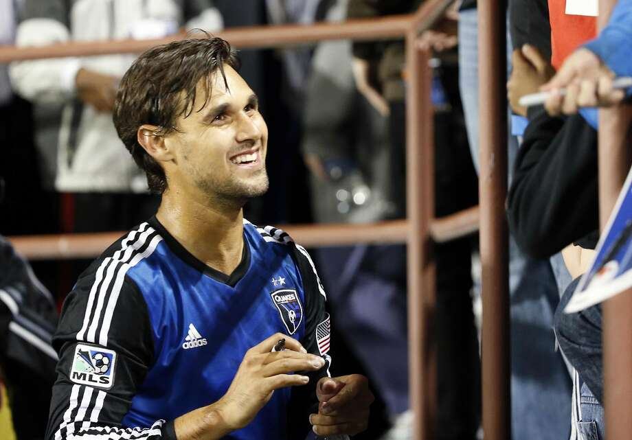 FILE-- San Jose Earthquakes forward Chris Wondolowski (8) signs autographs for fans in the stands after the game against the Chivas USA at Buck Shaw Stadium on April 26, 2014. Photo: Robert Stanton, Reuters