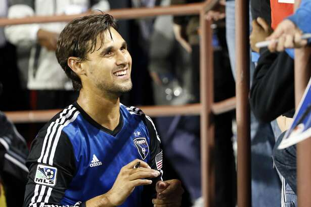 Apr 26, 2014; Santa Clara, CA, USA; San Jose Earthquakes forward Chris Wondolowski (8) signs autographs for fans in the stands after the game against the Chivas USA at Buck Shaw Stadium. San Jose won 1-0. Mandatory Credit: Bob Stanton-USA TODAY Sports