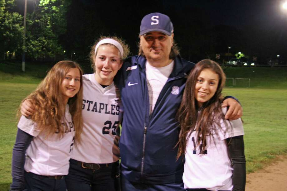 From left: Sonia Klein, Emily Lustbader, coach Luigi Cammarota and Gabby Perry before a Staples softball game against New Canaan Tuesday. Photo: Contributed Photo / Westport News Contributed