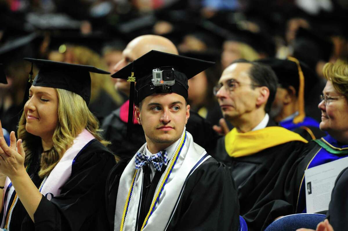 Michael Sampson, of Shelton, films with his GoPro camera attached to his cap during Southern Connecticut State University's Commencement 2016 Undergraduate Ceremony at the Arena at Harbor Yard on Friday.