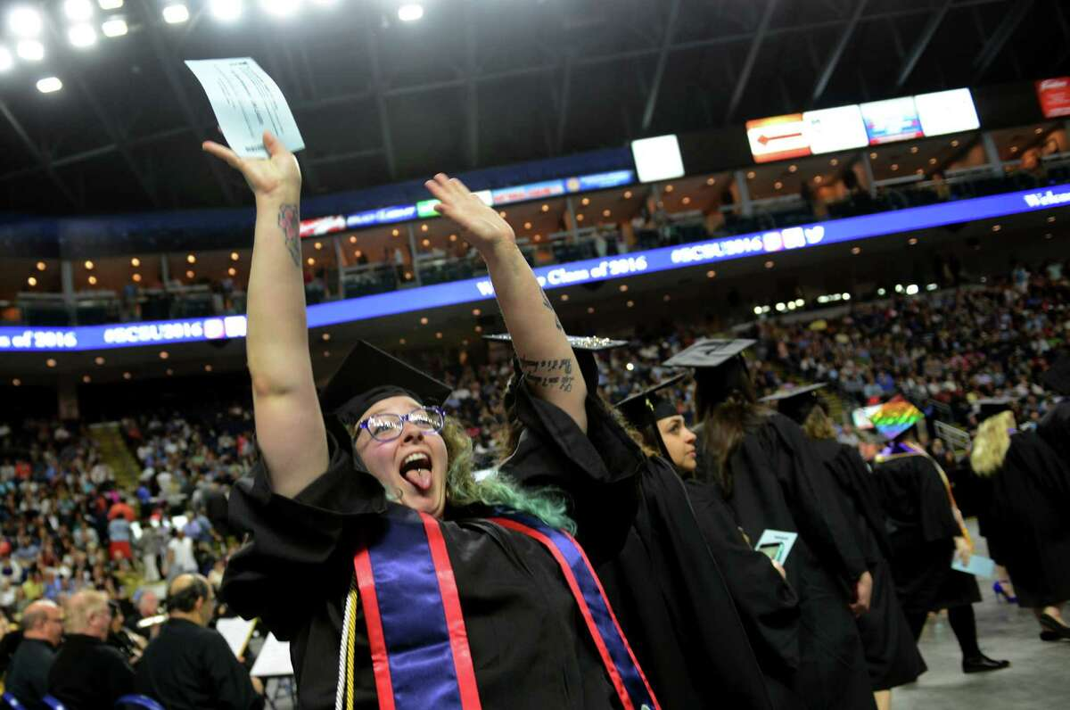 Above, Cori Kelemencky, of Woodbury, waves to her family at the start of Southern Connecticut State University's Commencement 2016 Undergraduate Ceremony at the Arena at Harbor Yard in Bridgeport on Friday.