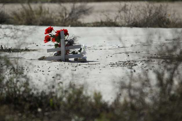 Crosses and flowers sit in the foundation of an apartment complex destroyed in the West Fertilizer Company explosion almost two and a half years after the disaster Thursday, Nov. 19, 2015, in West. ( Michael Ciaglo / Houston Chronicle ) Photo: Houston Chronicle