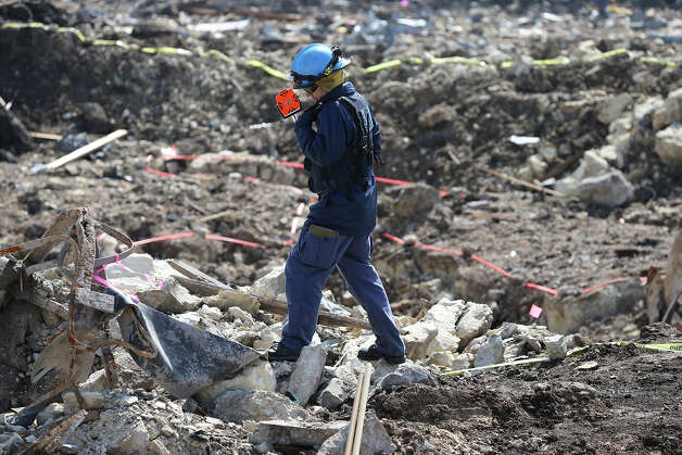 A forensic mapper climbs over the edge of the crater at the site of the fire and explosion in West, Texas on  April 24 2013. Photo: San Antonio Express-News