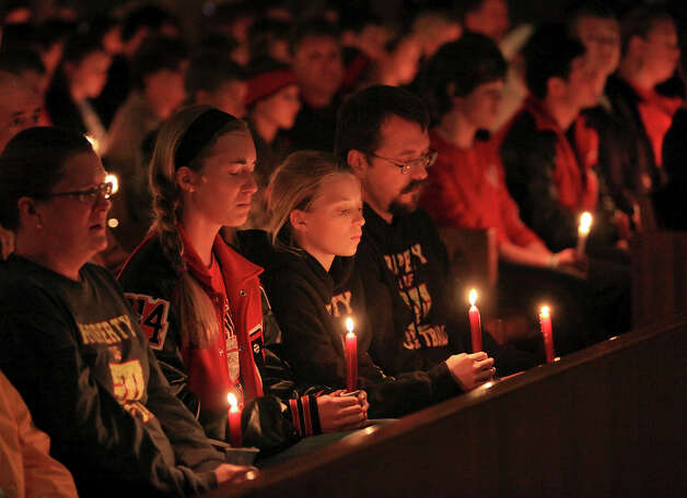 People pray,Thursday April 18, 2013, during a candlelight vigil at Church of the Assumption in West, Tx. for the explosion at a fertilizer plant that occurred Wednesday evening. Photo: San Antonio Express-News