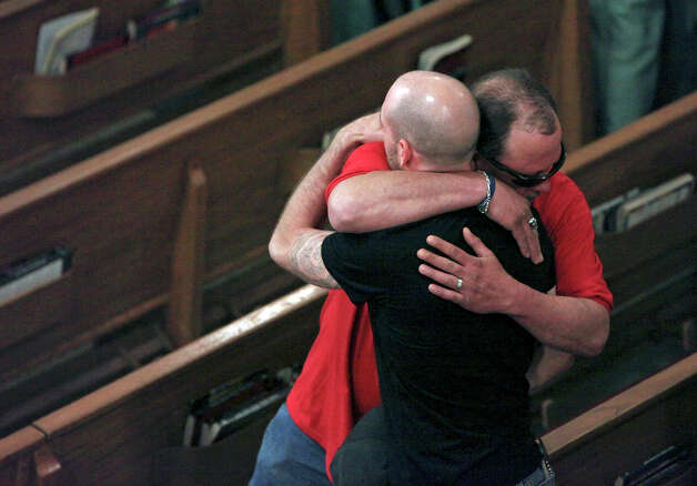 Jeff Clark (facing camera) comforts Dustin Matus, Sunday April 21, 2013, after a mass at the Church of the Assumption in West, Tx. Matus' father Jimmy Matus was killed in the explosion at a fertilizer plant that occurred Wednesday evening. Photo: San Antonio Express-News