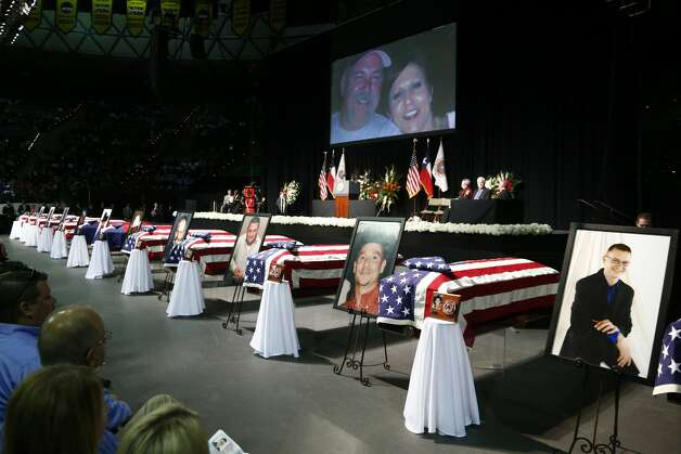 Casket sit in front of the stage of a memorial for firefighters who were killed in the West, Texas, fertilizer plant explosion prior to President Barack Obama's arrival, Thursday, April 25, 2013, at Baylor University in Waco,Texas. (AP Photo/Charles Dharapak) Photo: Associated Press