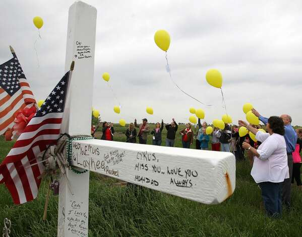 Balloons are released in memory of those who died a year ago in the West Fertilizer Plant explosion on Thursday, April 17, 2014.  Fifteen people were killed, including 12 volunteer firefighters and others responding to the fire, and more than 200 were injured. The  (AP Photo/Waco Tribune Herald, Jerry Larson) Photo: Associated Press