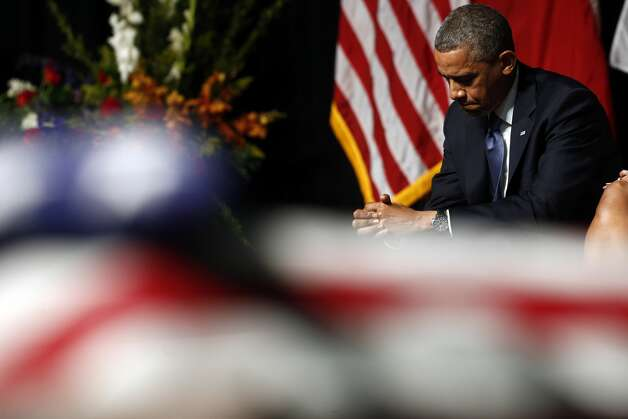 President Barack Obama attends the memorial for firefighters killed at the fertilizer plant explosion in West, Texas, at Baylor University in Waco, Texas, Thursday, April 25, 2013. (AP Photo/Charles Dharapak) Photo: Associated Press