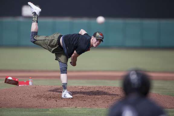 Former San Francisco Giants pitcher Tim Lincecum pitches during a showcase May 6 at Scottsdale Stadium in Scottsdale, Ariz.