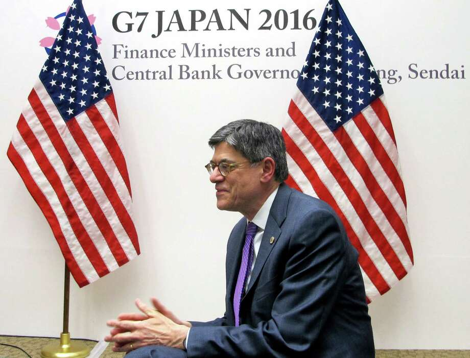 U.S. Treasury Secretary Jacob Lew talks to reporters Friday in Sendai, Japan. Group of Seven finance officials discussed ways to revitalize the global economy.  Photo: Elaine Kurtenbach, STF / AP