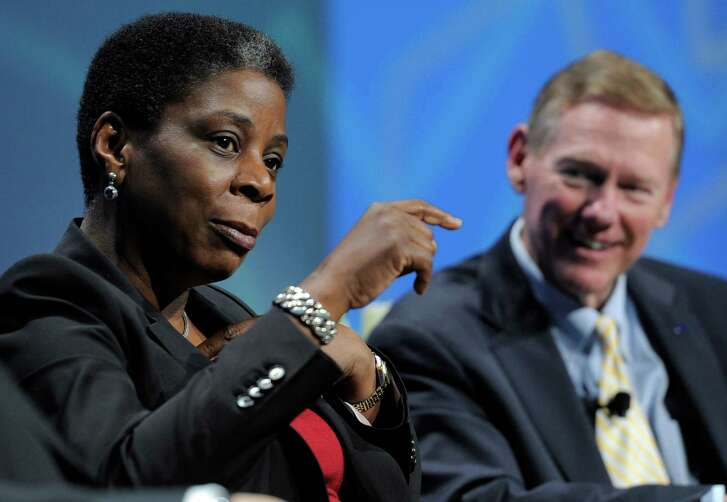 FILE - In this Wednesday, Jan. 11, 2012, file photo, Ursula Burns, president and chief executive officer of Xerox, talks as Alan Mulally, president and chief executive officer of Ford, looks on during a Power Panel discussion at the 2012 International CES in Las Vegas. Xerox says Burns won't be CEO after the company splits in two later in 2016. Burns became CEO of Xerox in 2009, becoming the first black woman to lead a Fortune 500 company. Xerox says after the split she will become chairman of a newly formed document technology company. (AP Photo/Jack Dempsey, File)