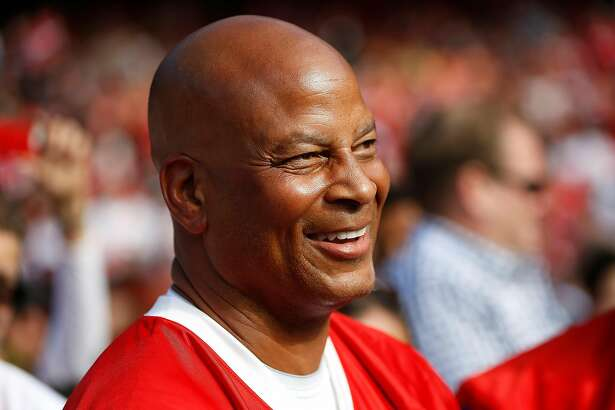 Former San Francisco 49ers Ronnie Lott smiles on the field before the Legends of Candlestick flag football game at Candlestick Park in San Francisco, Calif. on Saturday, July 12, 2014.