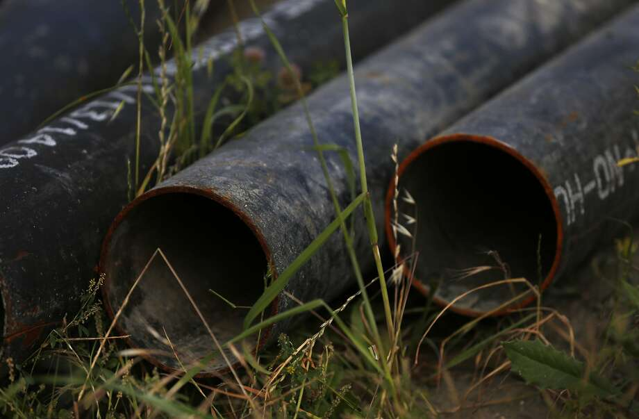 Pipes lay on the ground near the construction site at Hunters Point Shipyard in San Francisco. A ballot initiative would exempt the project from San Francisco's office-space cap under Proposition M. Photo: Leah Millis, The Chronicle