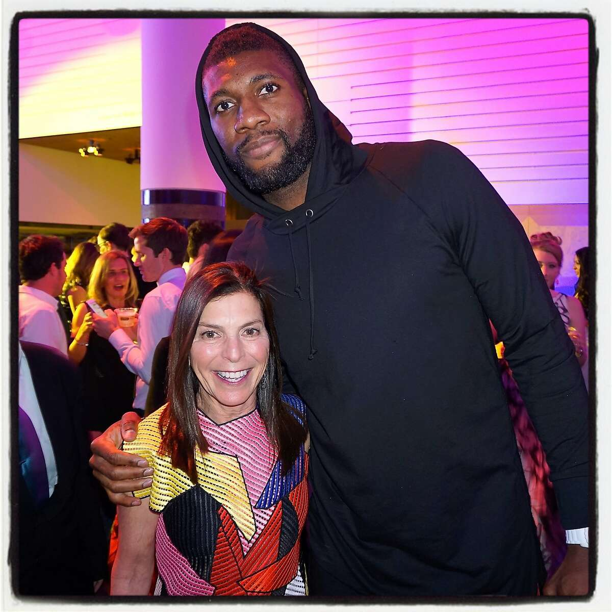 SFMOMA Trustee Susan Swig at the Modern Ball post-party with Warriors' Center Festus Ezeli. May 2016.