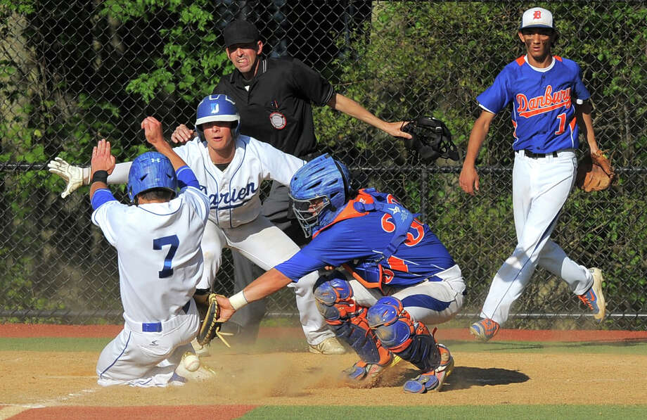 Darien Richard Brereton slides past the throw to Danbury catcher Mike Halas to score in the bottom of the fifth inning, along with James Schofield in an FCIAC baseball playoff game at Darien High School on Friday, May 20, 2016. Photo: Matthew Brown / Hearst Connecticut Media / Stamford Advocate