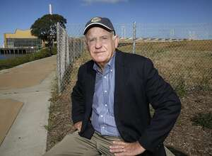 Richmond Mayor Tom Butt shows the five acre controversial Richmond Riviera project on the right of the Richmond Marina bay trail in Richmond, California, on Friday, May 20, 2016.   Developer is planning to build 59 luxury homes seeking support through a ballot measure.  Mayor Tom Butt would rather support ideas suited towards the historic past shipyard.