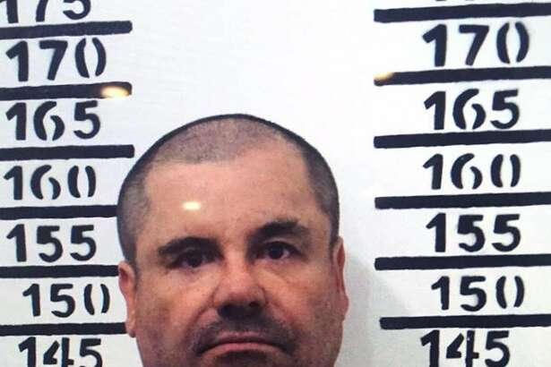 """(FILES) This police handout file photo taken on January 8, 2016 shows Joaquin Guzman Loera aka """"El Chapo"""" as he is imprisoned in Almoloya de Juarez, Mexico State.  Mexico approved on May 20, 2016 the extradition of drug lord Joaquin """"El Chapo"""" Guzman to the United States, where he faces narcotics and murder charges, the foreign ministry said. / AFP PHOTO / HO / HOHO/AFP/Getty Images"""
