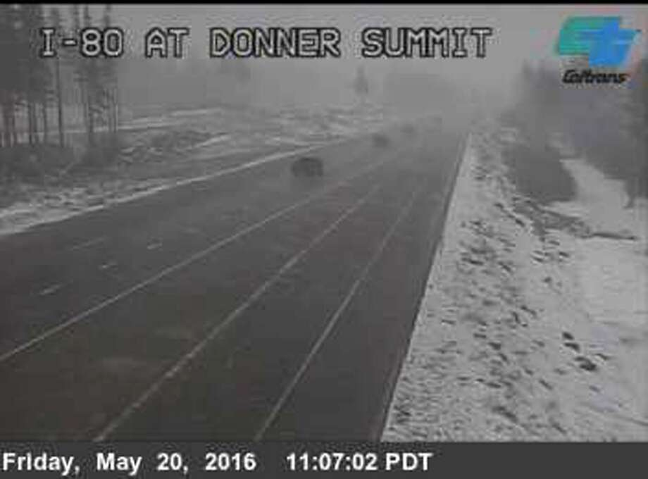 This photo from a California Department of Transportation camera shows snow falling and reduced visibility on Interstate 80 at the summit of Donner Pass near Truckee in the Sierra Nevada. A late spring storm with snow at higher elevations, wind, hail and rain elsewhere caused a rash of accidents and off-and-on closures of the main road between Sacramento and Reno. Photo: Associated Press