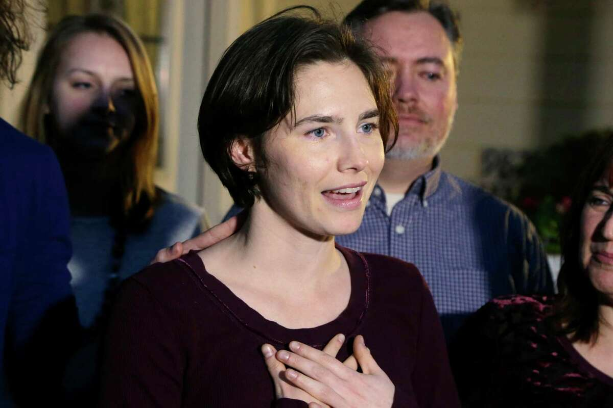 FILE - In this Friday, March 27, 2015 file photo, Amanda Knox talks to members of the media outside her mother's home in Seattle. The European Court of Human Rights has agreed to hear Amanda Knox's case challenging her slander conviction during the trial for her British roommate's 2007 murder, her Italian defense lawyer said Friday, May 20, 2016. Dalla Vedova said the Strasbourg court's decision this week is