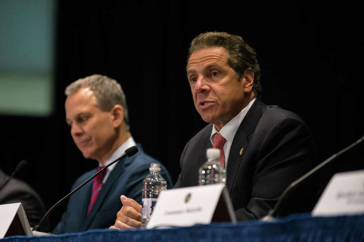 NEW YORK, NY - JULY 08: New York Governor Andrew Cuomo (R) issues an executive order putting the State Attorney General Eric Schneiderman (L) in charge of investigating allegations of police abuse at John Jay College on July 8, 2015 in New York City. Governor Cuomo signed the executive order in front of the families of men and women killed by police, including the mother of Eric Garner, Gwen Carr. (Photo by Bryan Thomas/Getty Images) ORG XMIT: 563900643