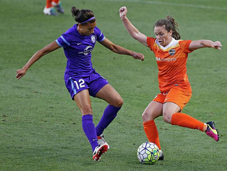 Orlando Pride defender Kristen Edmonds left, and Houston Dash defender Allysha Chapman right, during the first half of soccer game action at BBVA Compass Stadium Friday, May 20, 2016, in Houston.