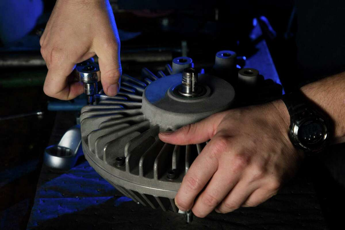 Joe Bivona, Orbital Traction test engineer, assembles a fan drive, Thursday, May 19, 2016, in Houston. Orbital Traction makes devices that reduces diesel emissions when added to truck engines. ( Marie D. De Jesus / Houston Chronicle )