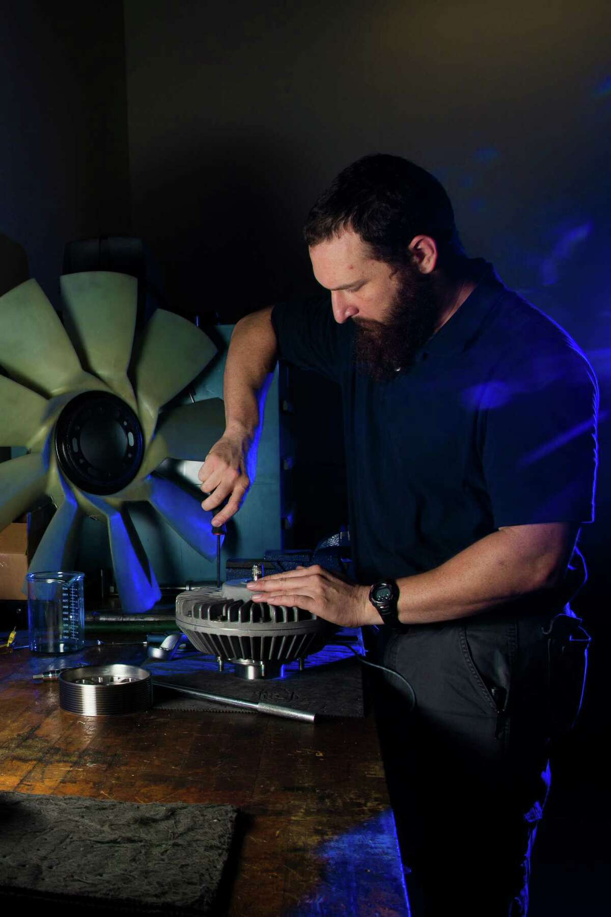 Orbital Traction test engineer Joe Bivona assembles a fan drive for a portrait, Thursday, May 19, 2016, in Houston. Orbital Traction makes devices that reduces diesel emissions when added to truck engines. ( Marie D. De Jesus / Houston Chronicle )