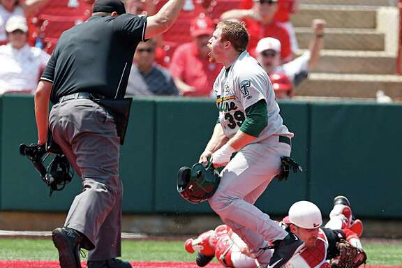 Tulane's Hunter Williams reacts after being tagged out by University of Houston catcher Jacob Campbell during the first game of a doubleheader.