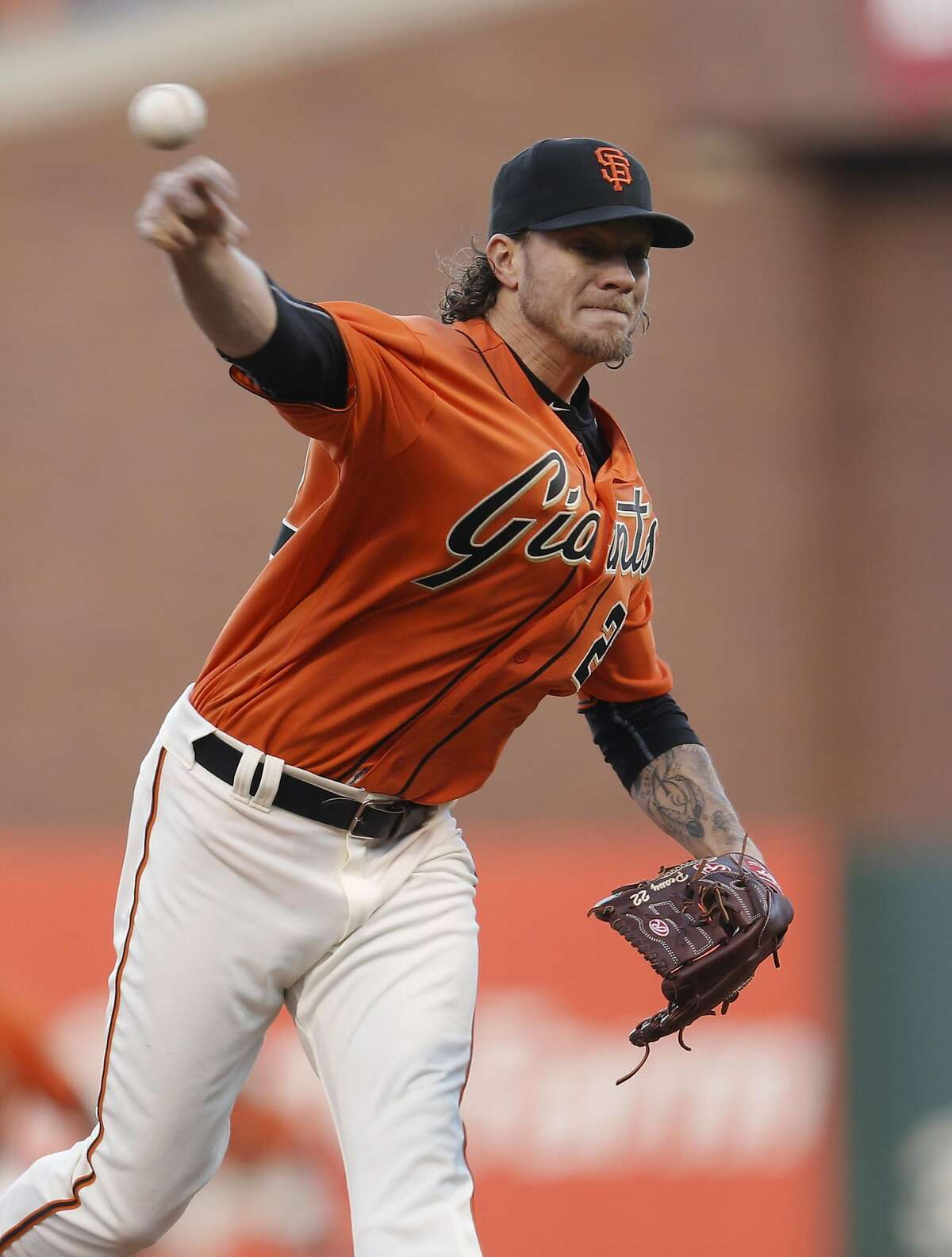 Giants' starting pitcher Jake Peavy throws in the first inning as the San Francisco Giants take on the Chicago Cubs at AT&T Park in San Francisco, California on Fri. May 20, 2016.