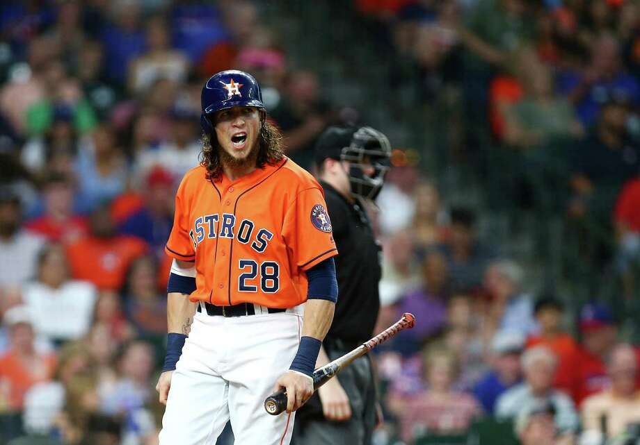 Oh well, another day, another holler. The Astros' Colby Rasmus doesn't take kindly to striking out in the fourth inning of a 2-1 loss to the Rangers on Friday night at Minute Maid Park. Rasmus struck out three times but did drive in his team's only run in the ninth. Photo: Jon Shapley, Staff / © 2015  Houston Chronicle