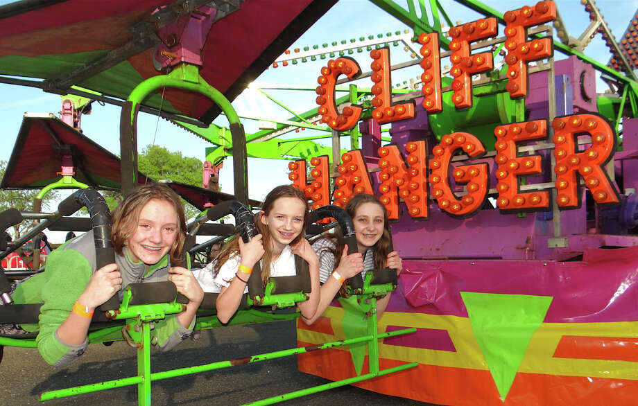 Fairfielders Julia Roche, Kelly Voltz and Danielle Hazelton ride the Cliff Hanger at the first night of Holy Family Church's carnival at Jennings Beach. Photo: Fairfield Citizen / Mike Lauterborn / Fairfield Citizen