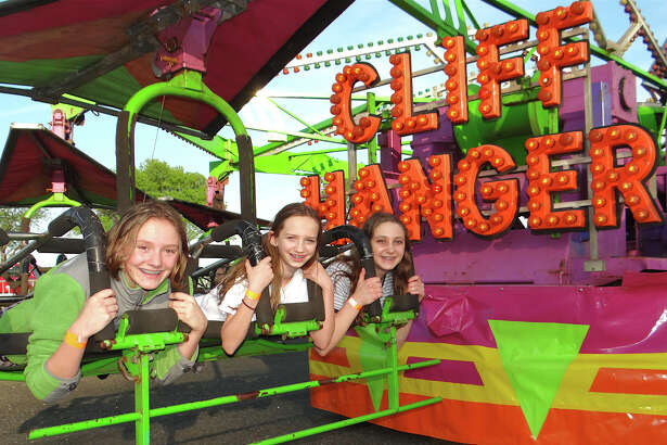 Fairfielders Julia Roche, Kelly Voltz and Danielle Hazelton ride the Cliff Hanger at the first night of Holy Family Church's carnival at Jennings Beach.