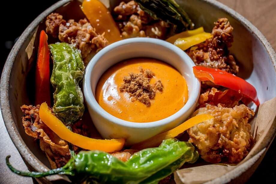 Fried oysters come with both pickled and blistered peppers and a deviled aïoli at Basalt. Photo: John Storey, Special To The Chronicle