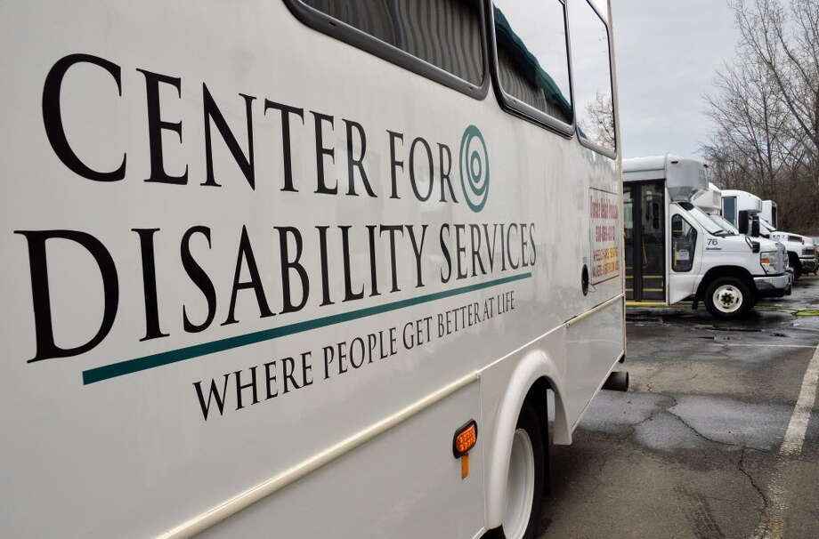 Vans sit outside of the Center for Disability Services at 700 S. Pearl Street Tuesday morning Dec. 9, 2014 in Albany. A state audit found issues with bonuses and other expenses by the Albany-based Center for Disability Services. (Times Union file photo)