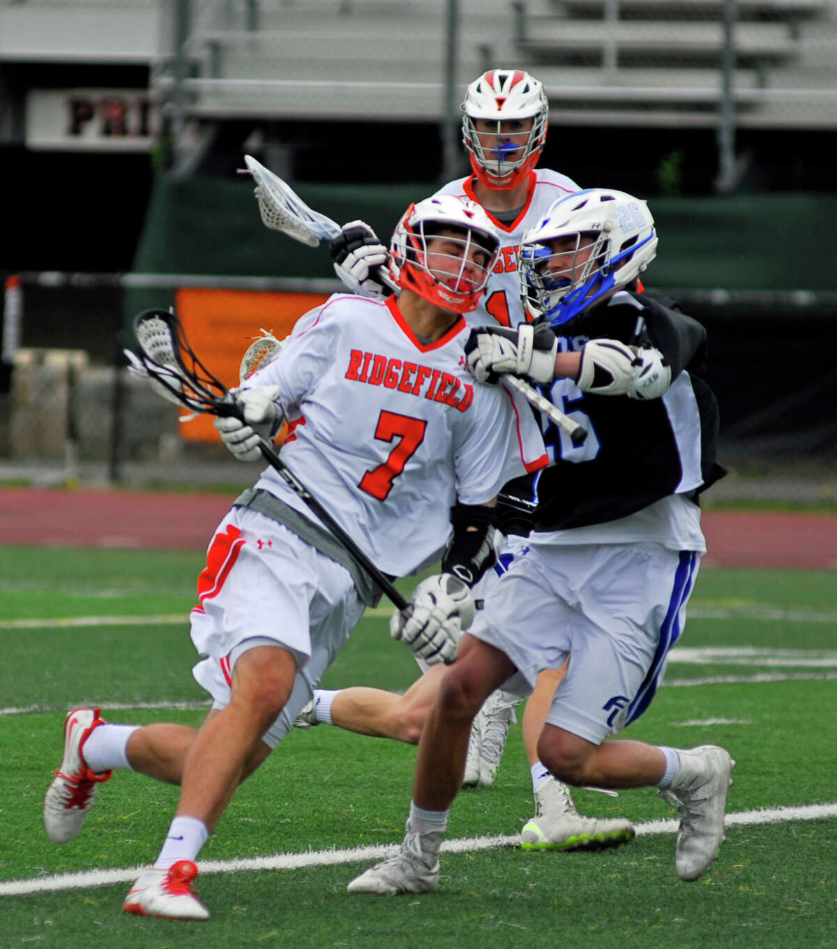Ridgefield's Greg Gatto, left, and Ludlowe's Henry Purdy clash during FCIAC quarterfinal action on Saturday.