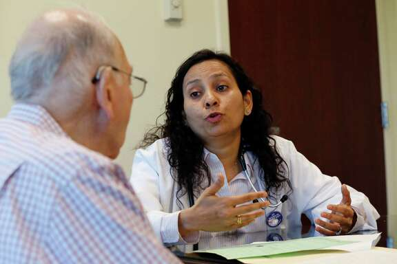 ADVANCE FOR USE MONDAY, MAY 23, 2016 AND THEREAFTER - In this Wednesday, April 13, 2016 photo, Herbert Diamond, left, 88, of Fort Lee, N.J., meets with Dr. Manisha Parulekar about his end of life preferences at the Hackensack Medical Center in Hackensack, N.J. Some doctors had already incorporated end-of-life planning into regular visits, and certain private insurers began offering reimbursement for it before Medicare announced its change. But because Medicare is the single largest payer of health care in the U.S., this could stand to be one of the most significant developments in end-of-life care ever seen in the country. (AP Photo/Julio Cortez)