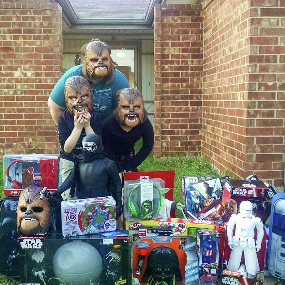 Candace Payne and her two children were surprised by Kohl's representatives with free toys after Payne's video of her trying on a Chewbacca mask went viral on Facebook.