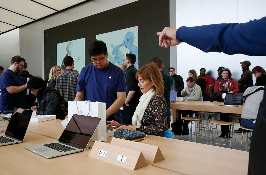 An Apple employee helps a customer set up her new iPad Pro at the Apple store on Union Square in San Francisco, Calif. Photo: Leah Millis / The Chronicle