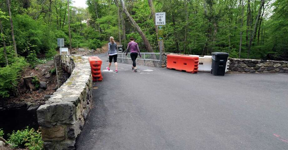 Visitors to Mianus River Park and a homeowner use this bridge on Merriebrook Lane in Stamford's Westover neighborhood, shown on May 17, 2016. Photo: Matthew Brown / Hearst Connecticut Media / Stamford Advocate