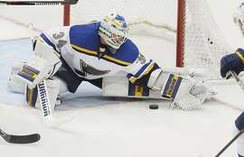 St. Louis Blues goalie Jake Allen (34) deflects a shot on goal during the second period of an NHL hockey game against the Dallas Stars Saturday, March 12, 2016, in Dallas. St. Louis won 5-4 in overtime. (AP Photo/Brandon Wade)