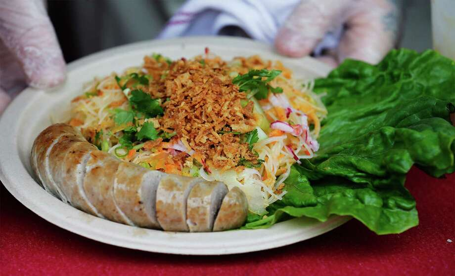 Chinese sausage with a noodle salad from Ming's Thing. Photo: Kin Man Hui /San Antonio Express-News / ©2016 San Antonio Express-News