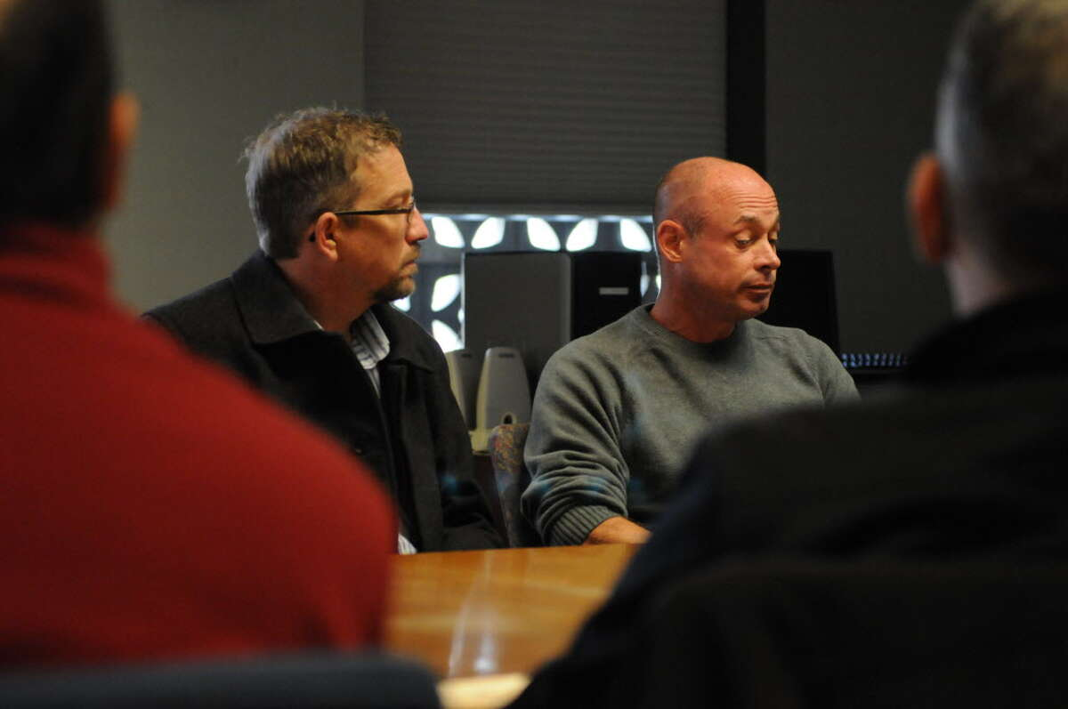Michael Flynn, left, and Jack Cesare, right, during a meeting at the Times Union in Nov. 2012. Flynn said that Father Gary Mercure exposed himself to Flynn in the early 1980s. Cesare, of Florida, was sexually abused by a janitor at St. Teresa of Avila in Albany, where the incident with Flynn also took place. (Will Waldron/Times Union)