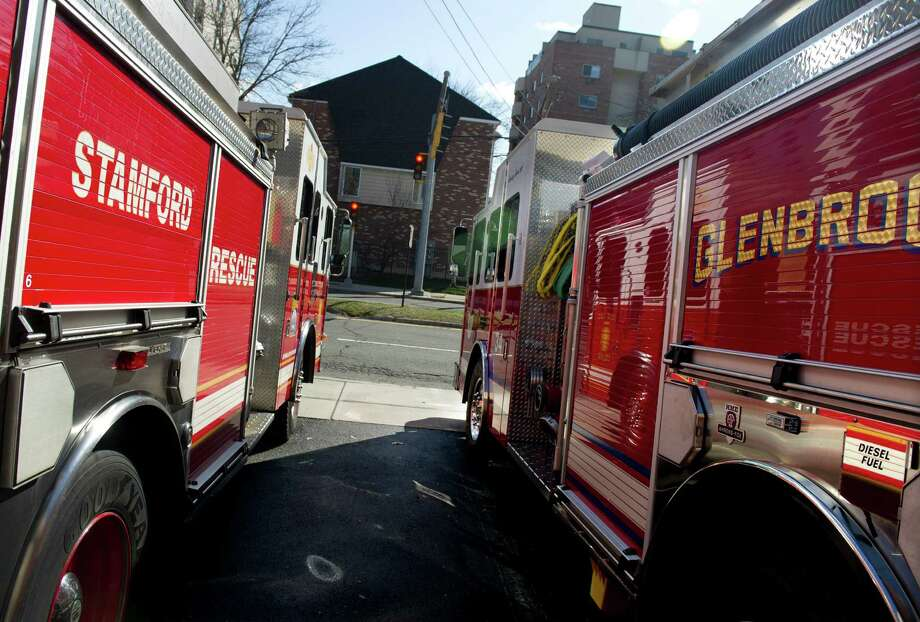 Fire trucks stationed at the Woodside fire station on Washington Boulevard. Photo: Lindsay Perry / Lindsay Perry / Stamford Advocate