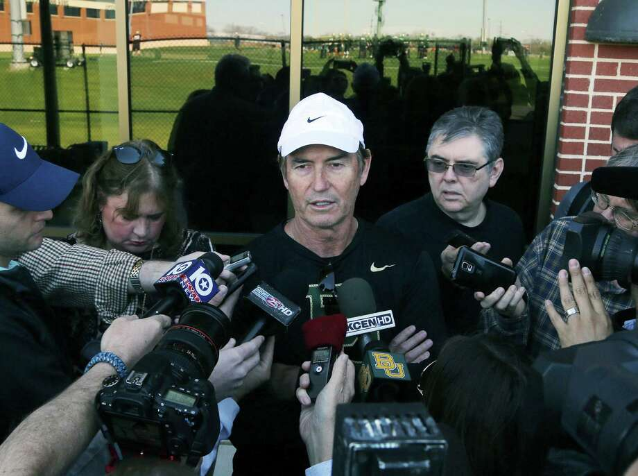 Baylor's Art Briles, center, believes his job as a football coach includes guiding his players along the right path if they make mistakes in life. Photo: Rod Aydelotte, MBO / Waco Tribune Herald