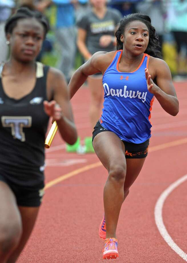 Saintphanie Porcenat runs the first leg of the girls 4x100 meter relay for Danbury during the FCIAC girls track championships, held at Bethel High School, Saturday, May 21, 2016, in Bethel, Conn. Photo: H John Voorhees III / Hearst Connecticut Media / The News-Times