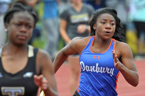 Saintphanie Porcenat runs the first leg of the girls 4x100 meter relay for Danbury during the FCIAC girls track championships, held at Bethel High School, Saturday, May 21, 2016, in Bethel, Conn.