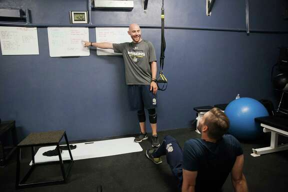 Missions strength and conditioning coach Dan Byrne shows the training routine for pitcher Bryce Morrow as part of the pregame routine on Tuesday May 18, 2016 at Wolff Stadium.