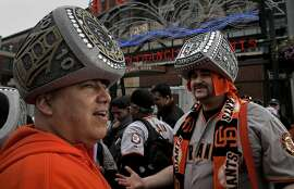 Dave Hernandez, (left) of Visali wears the 2010 championship ring while Ed Sandoval of Pittsburg wears the 2012 ring as they wait for the gates to open, for the San Francisco Giants' FanFest event at AT&T Park in San Francisco, Ca. on Saturday Feb. 7, 2015.